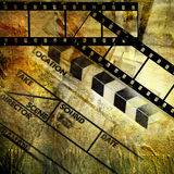 Old movie. Artistic background in grunge style with film strips Stock Images