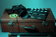 Old movie camera clapper and reel with film Stock Photos