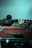 Old movie camera clapper and reel with film Royalty Free Stock Photo