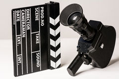Old movie camera with film clapperboard. Royalty Free Stock Photos