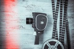 Old movie camera and film. Are on the painted table royalty free stock photos