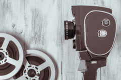 Old movie camera and film reel Stock Images