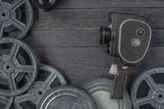 Old movie camera and film reel Stock Image