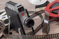 Old movie camera 16mm with reels films. An old movie camera 16mm with reels films royalty free stock photos
