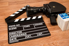 Old movie camera with a movie clapper and film Royalty Free Stock Photo