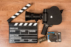 Old movie camera with a movie clapper and film. Stock Photo