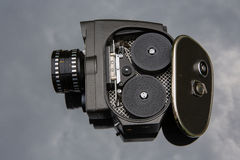 Old movie camera with open lavished channel Stock Photography