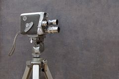 Old movie camera on painted background royalty free stock photography