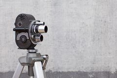 Old movie camera on painted background stock images