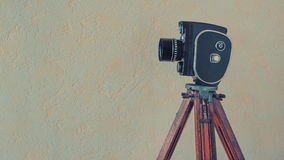 Old movie camera on a tripod Royalty Free Stock Photos