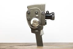 Old movie camera. On a wooden desk Stock Photography
