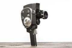 Old movie camera. On a wooden desk Stock Photo