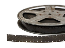Old movie film on metal reel close-up. Isolated on white royalty free stock image
