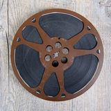 Old movie film reel 16mm. On the wooden table stock photos