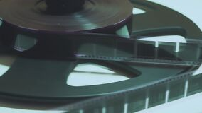Old movie film strip. scanner is scanning 35 mm film to digital close up. Restoration of an old movie. History.