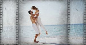 Old Movie tape video. Old Movie tape showing couple at the beach jumping into each other arms stock video footage