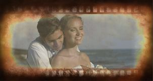Old Movie tape video. Old Movie tape showing couple at wedding day at the beach stock video
