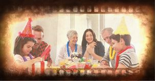 Old Movie tape video. Old Movie tape showing family celebration and children unwrapping gifts stock video footage