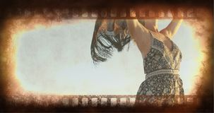 Old Movie tape video. Old Movie tape showing woman in the sun holding scarf in the wind at the beach stock video footage
