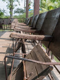 Old movie theater seats. Wood chairs Stock Photos