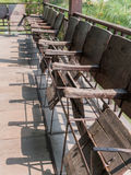 Old movie theater seats. Wood chairs Royalty Free Stock Images