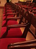 Old Movie Theatre Empty with red wooden chairs Royalty Free Stock Photo