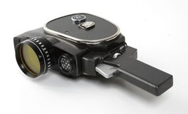 Old movies camera. Isolated on a white background Royalty Free Stock Photo