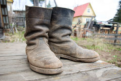 Old muddy farmers boots Royalty Free Stock Photos