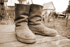Old muddy farmers boots Royalty Free Stock Photo