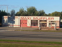 Old muffler shop. Out of bussiness muffler shop Stock Photos