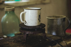 An old mug on the vintage electric stove Stock Images