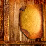 Old mulberry paper frame on old wooden board. Royalty Free Stock Images