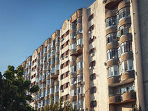 Old multi-storey apartment building with balconies Stock Photo