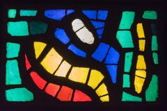 Old multicolored stained glass. Window Royalty Free Stock Photo