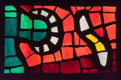 Old multicolored stained glass. Window Stock Photography