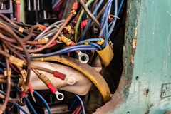Old multicolored wires in the electrical cabinet of mechanical equipment. royalty free stock photo