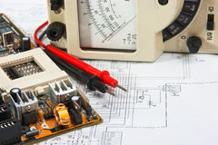 Old multimeter. On the wiring diagram royalty free stock photography