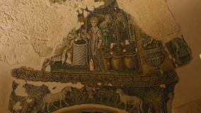 Old mural paintings with image of angel and lion, symbol of baptistery, church. Stock footage stock video