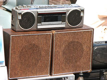 Old Music. A picture of an old tape-recorder/boombox with wooden vintage speakers below it depicting the old time music Royalty Free Stock Photography
