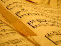 Old music notes. Old yellow sheets of music notes stock photos