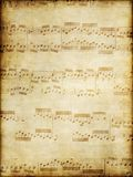 Old music on parchment. Music notes by Bach on old brown vintage paper Royalty Free Stock Photo