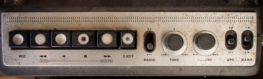 Old music player/radio panel button Stock Images