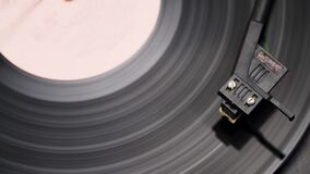 Old music record player. rapidly spinning. Music in the old days. Close-up top view