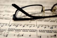 Old music sheet and glasses. Stock Photos