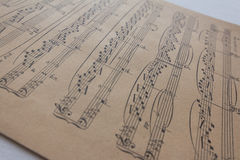 Old music sheet - music notes on yellow paper. Old music sheet - music notes on vintage paper Royalty Free Stock Images