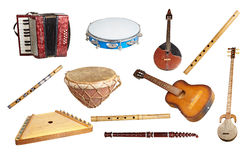 Old musical instruments. From around the world, isolated on white background Royalty Free Stock Images