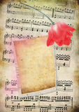 Old musical notes card. Old vintage musical notes card with red flower Royalty Free Stock Photos
