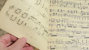 Old musical score. Follow the music in a musical score stock video footage