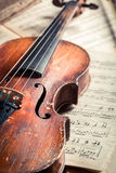 Old musical sheets and violin Stock Images