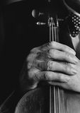 Old Musician Hands. Musician's hands with his violin royalty free stock images